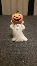 Ceramic Ghost Figurine Holding A Jack O Lantern