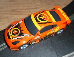 Rare vintage orange Scalextric Nissan 350z drift car - superb - does 360 spins