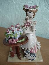 """Laura Dunn Studio Pottery Figurine """"Lady arranging flowers with cat"""""""