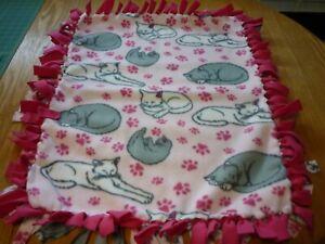 Handmade fleece tie blanket of sleeping cats for a small pet