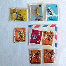 Lot of 8 Singapore stamps~1963 & 1968~birds~kingfisher~sunbird~tern~lion dance