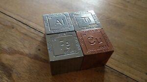 Set de 4 cubos de 31mm (pesos s/densidad) de Titanio, Aluminio, Cobre y hierro