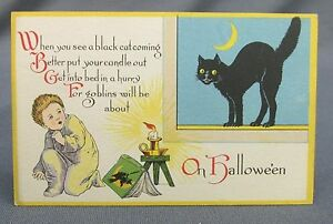 Antique Halloween Postcard Black Cat in Window Scared Boy Candle Witch Book