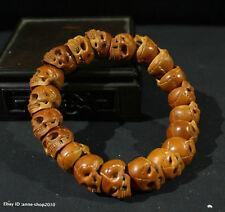 1.3CM China Olivary nucleus wood Handmade Jewelry Skull head Bead Bracelet AAAA
