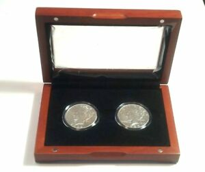 PEACE SILVER DOLLARS Pair of Coins Encased in Brilliant Uncirculated Condition