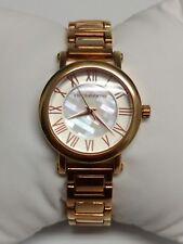 B038 Jcpennys Liz Claiborne Watch rose gold tone Roman numerals pearl accent
