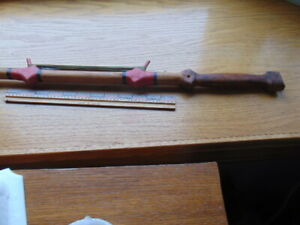 Antique carved and painted ice fishing pole w/ spike end