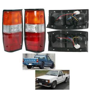Dodge RAM 50 Mitsubishi Pickup Truck Set of Taillights Black Bezels