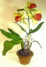 ARTIFICIAL RED & GREEN ORCHID WITH A WHITE BUTTERFLY IN A TERRACOTTA PLANTER