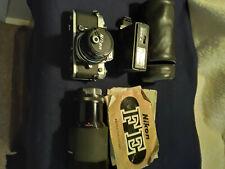 Nikon Fe 35mm Slr Film Camera W/ flash unit and extra lens