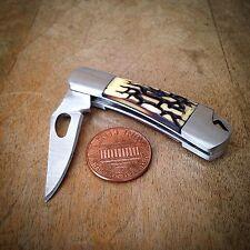 Jigged Bone Knife Pendant, Steel Silver Charm, Jewelry Miniature Folding Knives