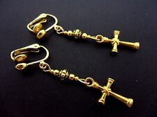 A PAIR OF CUTE GOLD COLOUR  DANGLY CROSS  CLIP ON EARRINGS. NEW.