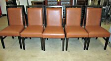 Sleek Dark Wood Dining Chairs with Orange/Tan Upholstered Seat & Back