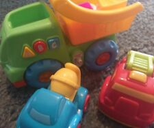 Fisher Price color and shapes electronic dump truck plus 2 other play trucks