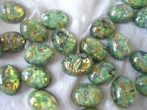 Full package of 36 Czech. glass Green Opal Ovals in 14x10mm.