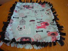 Handmade fleece tie blanket of sketched puppies for a small pet