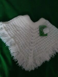 Hand-knitted  child's white poncho  age 1