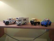 Lot of 4 smaller Tonka trucks. Winnebago, tow truck, dump truck, pickup truck
