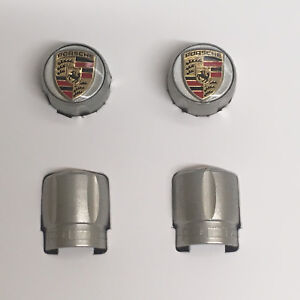 PORSCHE DESIGN OEM FACTORY NEW TPMS APPROVED CRESTED VALVE STEM CAPS IN SILVER.