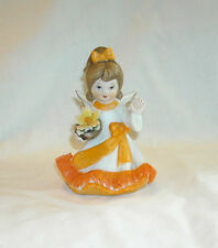 VINTAGE SMALL UCGC PONYTAIL ANGEL WITH YELLOW FLOWER IN BASKET