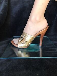 Gucci  golden leather / wooden heels / open toes , slip on shoes. Size 7. New