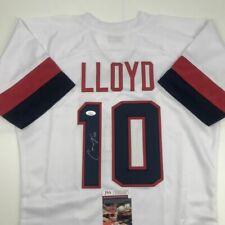 Autographed/Signed CARLI LLOYD White Team USA Soccer USWNT Jersey JSA COA Auto