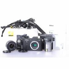 Nikon 1 V1 Systemkamera mit Nikkor 1 VR 3,3-5,6/10-30 Black