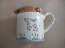 "Bella Casa by Ganz ceramic pitcher, cow motif, 4 1/4"" high, handled"