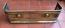 Antique brass fireplace and hearth fender