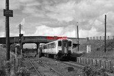 PHOTO  1986 A 3-CAR 450 CLASS PASSES THE REMAINS OF BARN STATION WITH THE 11.00