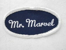 MR. MARVEL USED EMBROIDERED  SEW ON NAME PATCH TAG OVAL BLACK ON WHITE