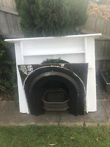 Antique fireplace With White Mantle Piece