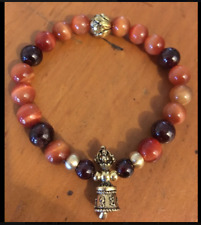 ॐCrystal Blissॐ Tiger Eye and Garnet Bracelet W Tibetan Dorje Vajra Bell Charm
