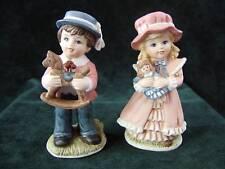 Pair of Homco Christmas Boy & Girl Figurines