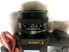 Canon T50 (film) camera with 50mm f1.8 FDn lens and flash
