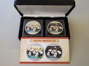 "Panda-Satz ""Night & Day"" 2013, 2 x 10 Yuan, je 1 Unze Silber, stgl., coloriert"