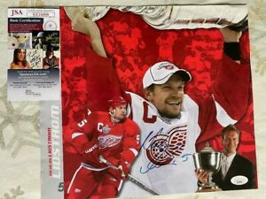 Autographed NICK LIDSTROM Red Wings Calendar page 12 X 10 1/2 JSA