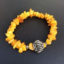 Genuine egg yolk butterscotch Baltic amber bracelet. Sterling silver beads.
