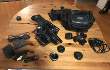 Panasonic Lumix GF-1 And Panasonic AG-AF1 Two Lenses And A Camera Bag
