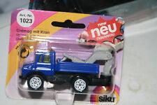 Siku 1023 Mercedes Benz UNIMOG U 1500 Pritsch + Heckbagger blau orig. verpackt