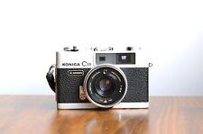 KONICA C35 Automatic 35mm Rangefinder Camera  w/ Leather case * Good Condition *