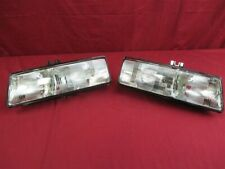 NOS OEM Pontiac Bonneville Head Lamp Light 1988 - 1991 PAIR