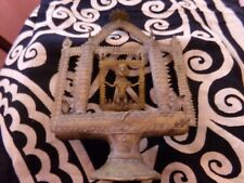 Antique khmer shrine with deity