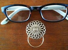 The mattie gold tone magnetic flower eyeglass holder