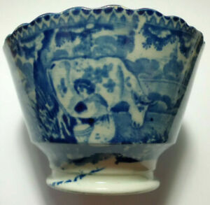 An unusual blue transfer printed cup of a girl milking a cow, English c.1810