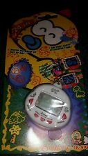 RETRO-WHITE VIRTUAL PETS 24 in 1 WATCH ME GROW CYBER PET TOY............. ENJOY