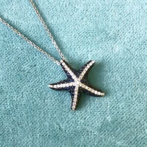 $2255 18kt White Gold Starfish Pendant Blue Sapphires & White Diamonds