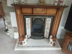 PINE FIRE SURROUND, LIVING FLAME GAS FIRE, TILED SURROUND AND HEARTH.