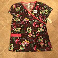 Women's scrub top tie in back bottom pockets size M