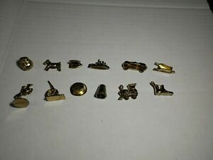 Monopoly lot 12 Tokens from 1995 Deluxe Edition Set Includes Gold Train